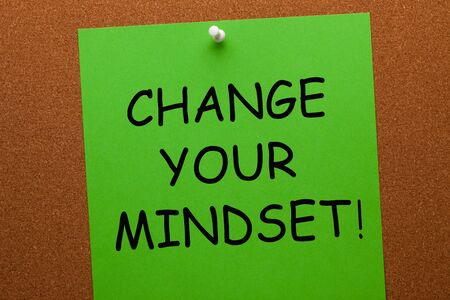 Change Your Mindset text on green paper sheet. Business concept. 写真素材
