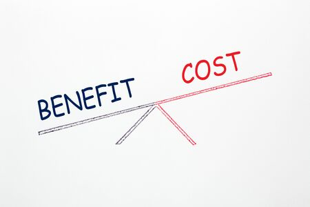 Drawing scale with opposite words Cost and Benefit on white background. Business concept. 写真素材