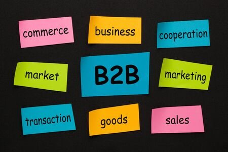 Text Business-to-Business (B2B) with conceptual words on colorful stickers on black background. Business concept.