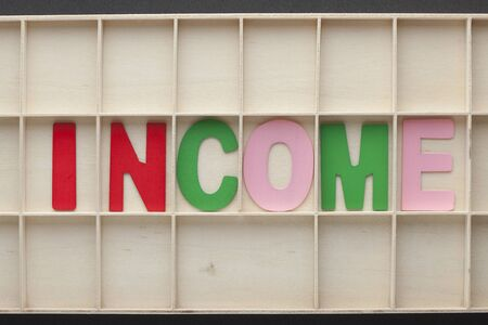 The word spelled from colored wooden letters on wooden surface. Business Concept. 写真素材