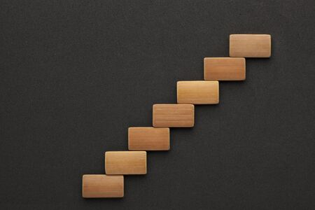 Seven wooden blocks in the shape of a staircase. Business concept. 写真素材