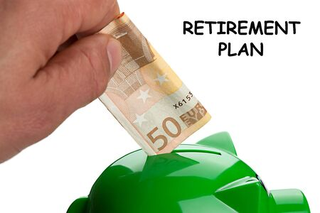 Hand putting banknote on a piggy bank and text Retirement Plan. Stop working. Pension concept.