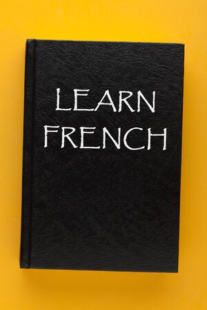 Learn French text in a book cover on a yellow background. 写真素材