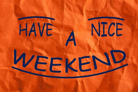 Have a Nice Weekend text on wrinkled lined paper. Business concept.
