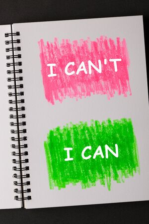 I Cant and I Can text on painted sketchbook in red and green. Business concept.