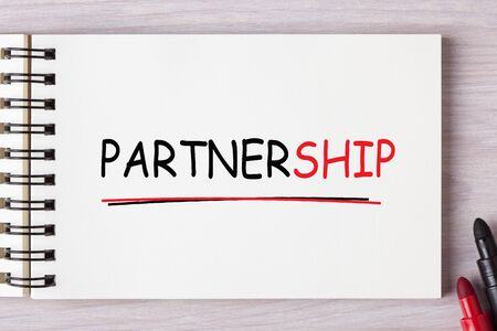 The word Partnership written on notebook with black and red marker. Business concept. 写真素材