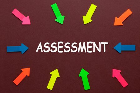 Colorful arrows pointing to word Assessment. Business Concept. 写真素材