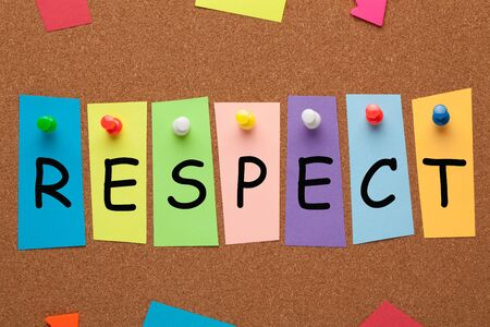 The word Respect written in colorful stickers pinned on cork board. Business concept.