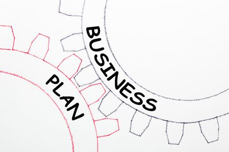 The words Business Plan written on mechanism of gears.