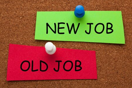 The words New Job versus Old Job on colorful stickers pinned on cork board. Business concept