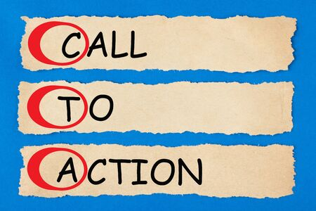 Call To Action written text on torn pieces of paper. Acronym CTA. 版權商用圖片