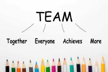 Together Everyone Achieves More (TEAM) and colored pencil on white background . Business acronyms Zdjęcie Seryjne