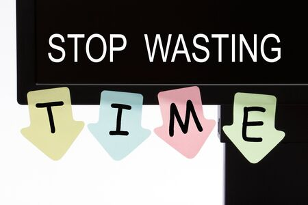 Stop Wasting Time text on computer display and reminder notes. Business concept.