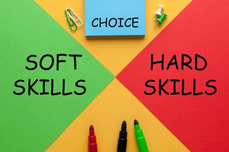The words Hard Skills vs. Soft Skills choice on red vs. green triangle with various stationery.