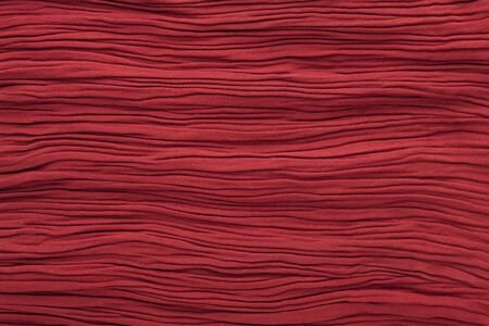 Red color textile fabrics for background or texture, wrinkled and shadows