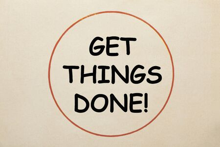 Get Things Done text in circle on old paper sheet. Stock fotó