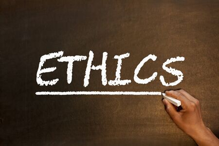 The word Ethics handwriting with chalk on blackboard. Business concept.