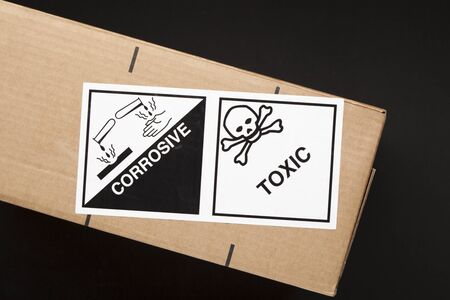 Toxic and Corrosive label for transportation of hazardous chemicals present