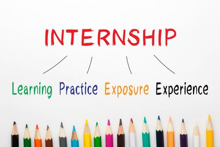Internship and colored pencils with keywords on a white background. Фото со стока - 132487162
