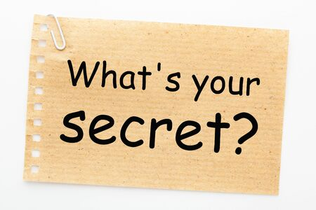 Whats your secret text on sheet of recycled paper on white background.