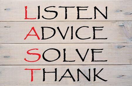 Listen, advice, solve and thank written on a wood planks grunge wall pattern. LAST acronym Фото со стока - 132487167