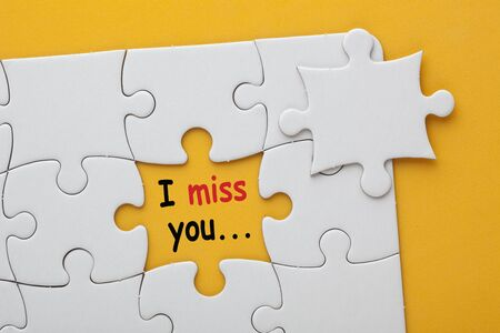 Missing jigsaw puzzle piece with text I miss you