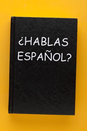 Question Hablas Espanol? do you speak spanish? text on a book cover.