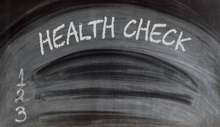 Health Check blank list on blackboard. Empty space for text. Medical concept.