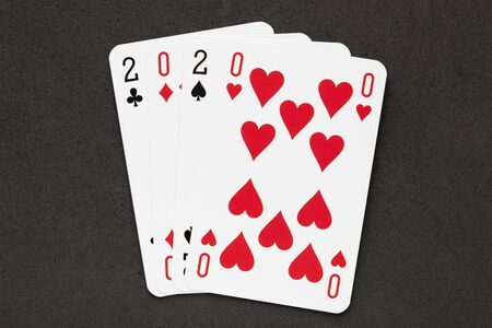 2020 concept playing cards on black background. Фото со стока - 131400281