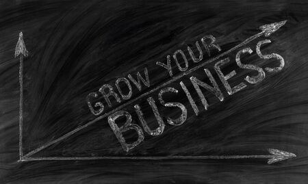 Grow your business text on a blackboard Фото со стока - 131620371
