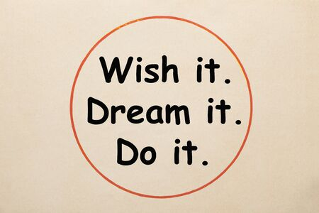 Wish It, Dream It, Do It motivational and inspirational quote in circle on old paper sheet. Stockfoto