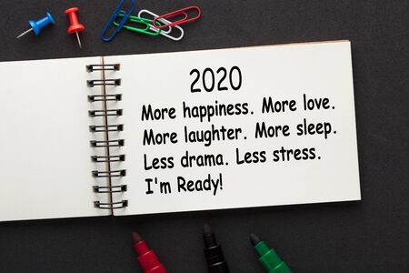 More happiness. More love. More laughter. More sleep. Less drama. Less stress. Im Ready! text on open spiral notebook and various stationery. Stockfoto