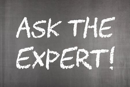Ask the Expert written on blackboard. Business concept.