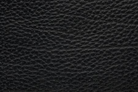 Black skin cowhide genuine leather background Фото со стока