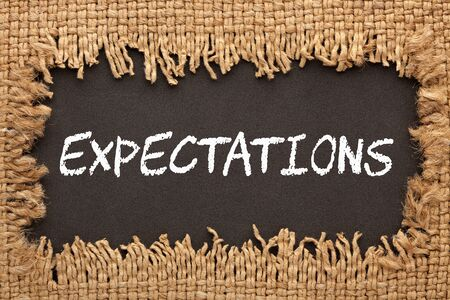Piece of burlap with hole with the word Expectations. Business concept Stockfoto