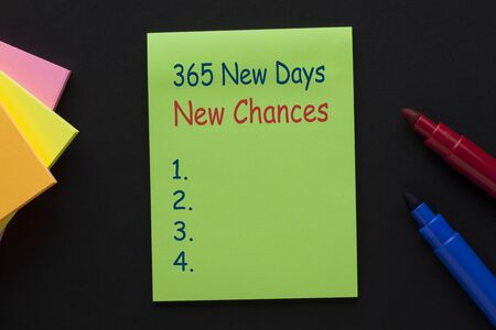 The text 365 New Days New Chances blank list written on note
