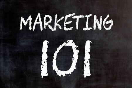 Text Marketing 101 written on blackboard. Business concept