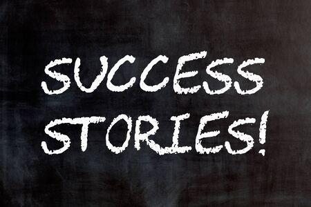 Words Success stories written on blackboard.  Concept of testimonials.