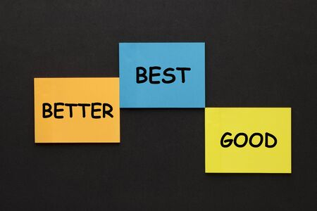 Words Good Better Best on notes in the shape of a pedestal for winners. Business Concept.