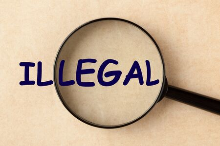 Magnifying glass hovering over illegal to find the legal. Change concept