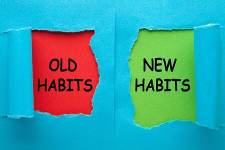 New Habits vs Old Habits words on blue torn paper in red and green background. Business concept