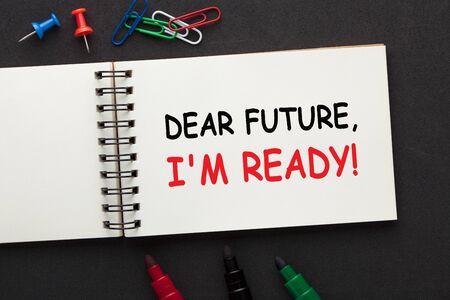 Dear Future, I Am Ready text on open spiral notebook and various stationery. Business concept. Фото со стока