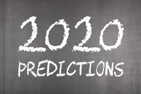 2020 Predictions written on blackboard. Business concept.