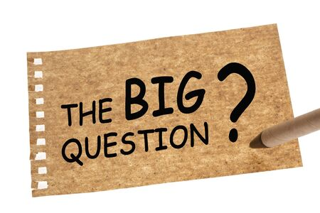 The Big Question with a big question mark on recycled paper sheet and recycled paper pen. Foto de archivo