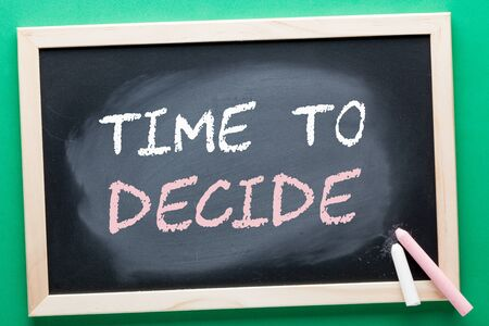 Time to Decide written on blackboard and color chalks. Business concept. Archivio Fotografico