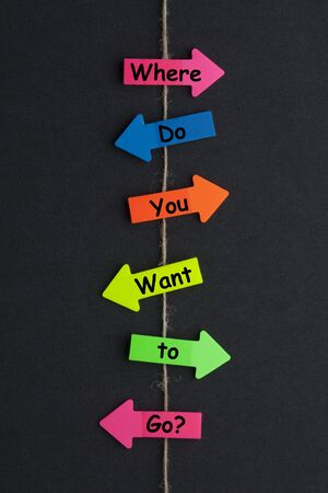Where do you want to go? concept of colored arrows on black background.