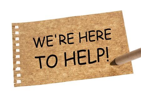 We are here to help written on recycled paper sheet and recycled paper pen.