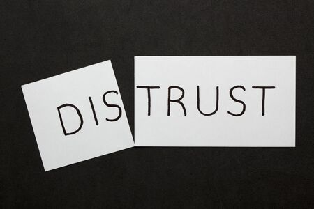 Changing word distrust transformed to trust on a white sheet
