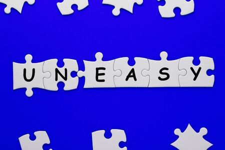 Changing word uneasy transformed to easy on puzzle.