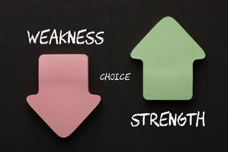 Strength or weakness concept with arrows on black background. Business concept